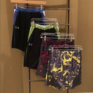 Four UA Athletic Shorts